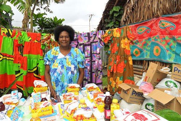Vanuatu woman selling dresses